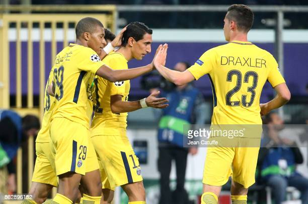 Angel Di Maria of PSG celebrates his goal with Kylian Mbappe Julian Draxler during the UEFA Champions League match between RSC Anderlecht and Paris...