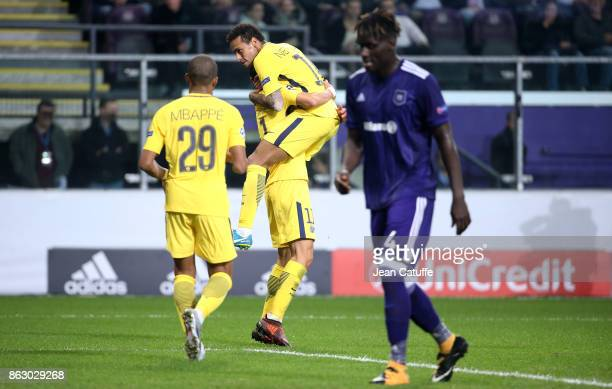 Angel Di Maria of PSG celebrates his goal with Neymar Jr while Serigne Kara Mbodji of Anderlecht looks on during the UEFA Champions League match...