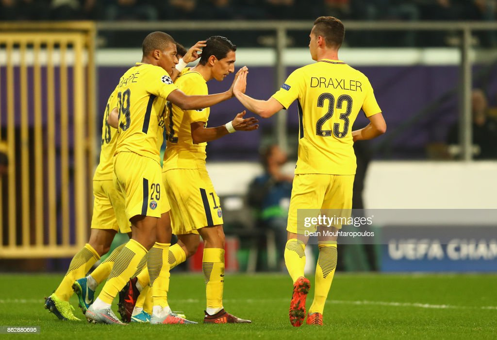 Angel Di Maria of PSG celebrates scoring his sides fourth goal with his PSG team mates during the UEFA Champions League group B match between RSC Anderlecht and Paris Saint-Germain at Constant Vanden Stock Stadium on October 18, 2017 in Brussels, Belgium.