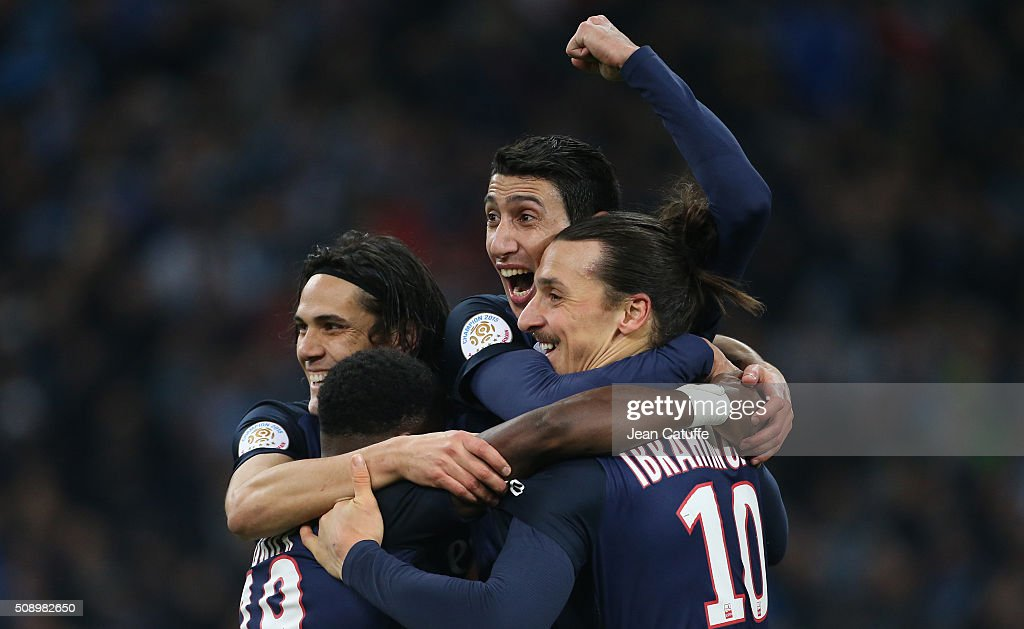 Angel Di Maria of PSG celebrates with <a gi-track='captionPersonalityLinkClicked' href=/galleries/search?phrase=Edinson+Cavani&family=editorial&specificpeople=4104253 ng-click='$event.stopPropagation()'>Edinson Cavani</a> (left) and <a gi-track='captionPersonalityLinkClicked' href=/galleries/search?phrase=Zlatan+Ibrahimovic&family=editorial&specificpeople=206139 ng-click='$event.stopPropagation()'>Zlatan Ibrahimovic</a> (right) scoring the second and winning goal for Paris during the French Ligue 1 match between Olympique de Marseille (OM) and Paris Saint-Germain (PSG) at New Stade Velodrome on February 7, 2016 in Marseille, France.