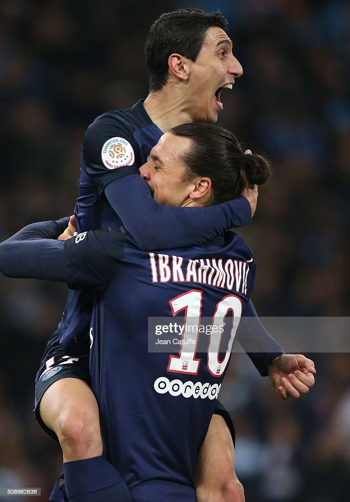 Angel Di Maria of PSG celebrates with <a gi-track='captionPersonalityLinkClicked' href=/galleries/search?phrase=Zlatan+Ibrahimovic&family=editorial&specificpeople=206139 ng-click='$event.stopPropagation()'>Zlatan Ibrahimovic</a> scoring the second and winning goal for Paris during the French Ligue 1 match between Olympique de Marseille (OM) and Paris Saint-Germain (PSG) at New Stade Velodrome on February 7, 2016 in Marseille, France.