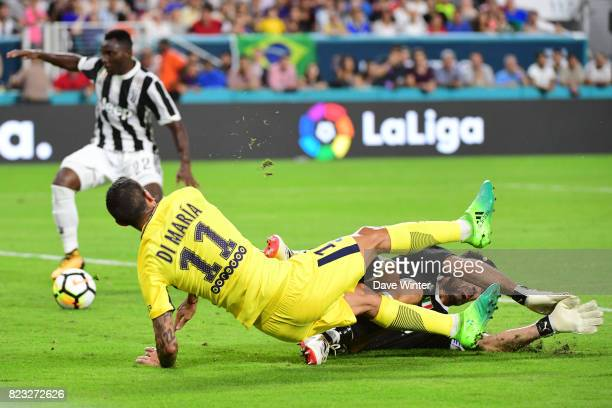 Angel Di Maria of PSG collides with goalkeeper Gianluigi Buffon of Juventus after giving the pass that allows Goncalo Guedes of PSG to score during...
