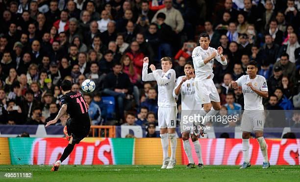Angel Di Maria of PSG shoots from a free kick during the UEFA Champions League Group A match between Real Madrid CF and Paris SaintGermain at Estadio...