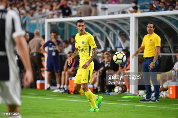 Angel Di Maria of PSG under the watchful eyes of PSG coach Unai Emery during the International Champions Cup match between Paris Saint Germain and...