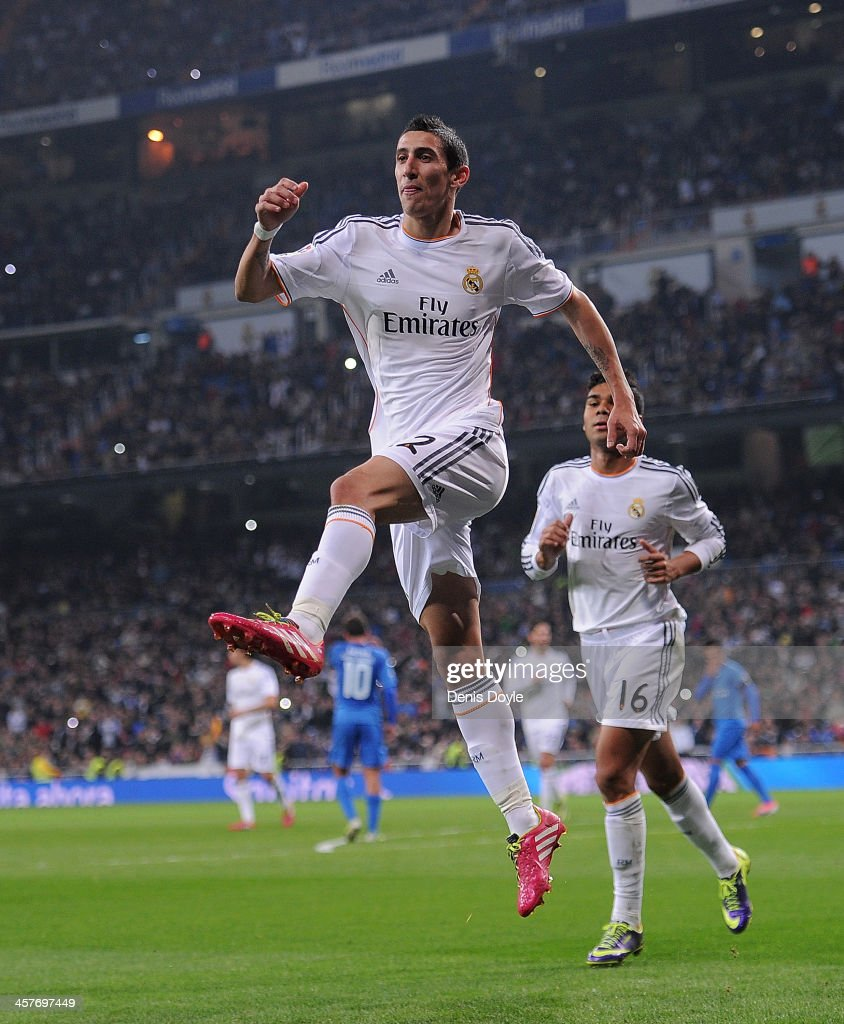 Angel di Maria of Real Madrid celebrates after scoring Real's 2nd goal during the Copa del Rey, Round of 32 2nd leg match between Real Madrid and Olimpic de Xativa at Santiago Bernabeu stadium on December 18, 2013 in Madrid, Spain.