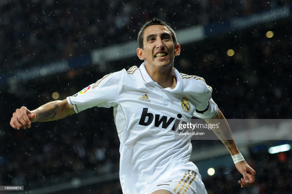 Angel Di Maria of Real Madrid celebrates scoring his sides third goal during the la Liga match between Real Madrid and Villarreal at the Estadio Santiago Bernabeu on October 26, 2011 in Madrid, Spain.