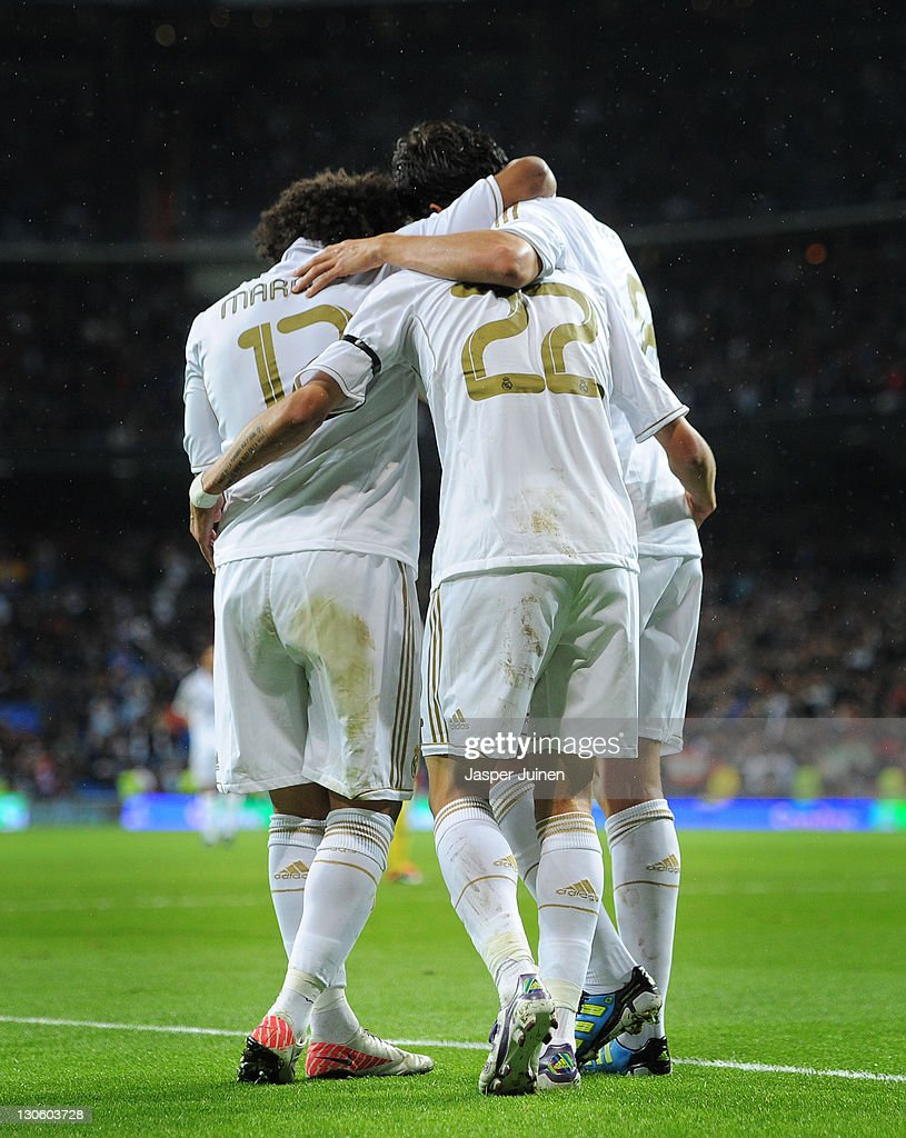 Angel Di Maria (C) of Real Madrid celebrates scoring his sides third goal with his teammates Marcelo (L) and Kaka during the la Liga match between Real Madrid and Villarreal at the Estadio Santiago Bernabeu on October 26, 2011 in Madrid, Spain.