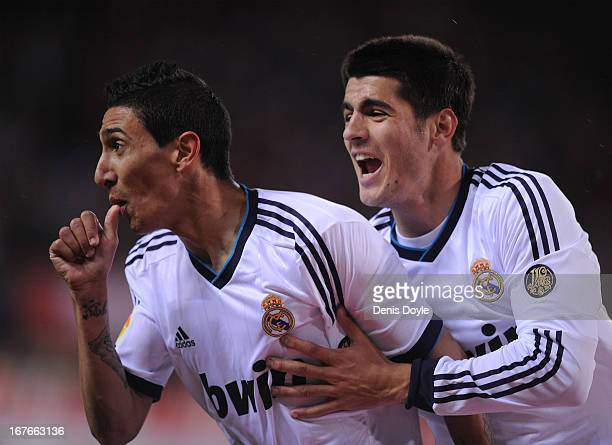 Angel di Maria of Real Madrid celebrates with Alvaro Morata after scoring Real's 2nd goal during the La Liga match between Atletico de Madrid and...