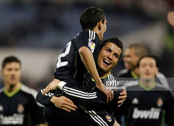 Angel di Maria of Real Madrid celebrates with his team mate Cristiano Ronaldo after scoring Real's third goal during the La Liga match between Real...