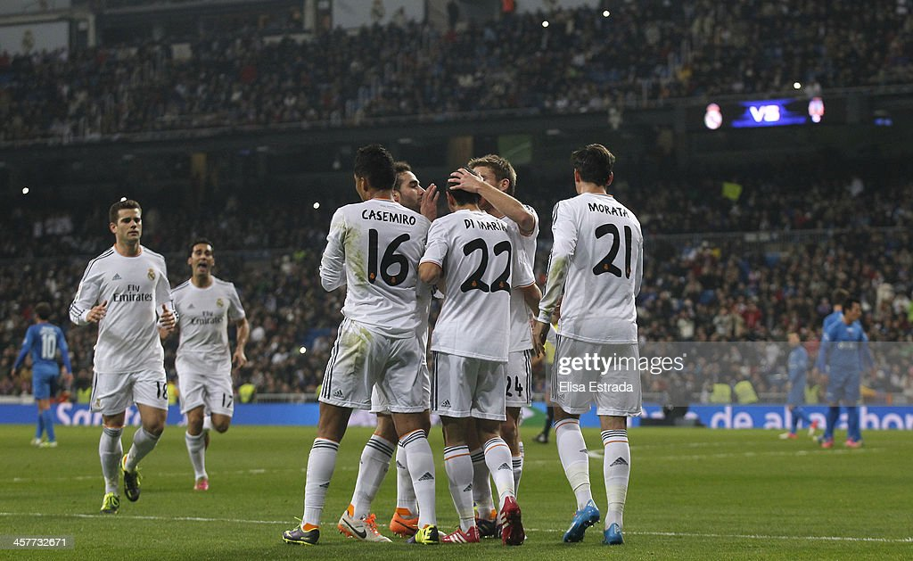 Angel di Maria of Real Madrid celebrates with his team mates after scoring during the Copa del Rey, round of 32 match between Real Madrid and Olimpic de Xativa at Estadio Santiago Bernabeu on December 18, 2013 in Madrid, Spain.