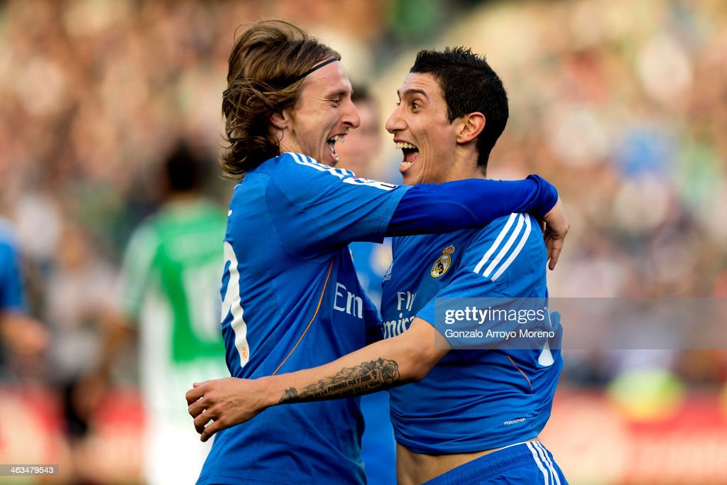 Angel Di Maria of Real Madrid CF celebrates scoring their fourth goal with teammate Luka Modric during the La Liga match between Real Betis Balompie...