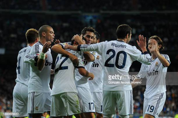 Angel Di Maria of Real Madrid CF celebrates scoring their second goal with teammates Sergio Ramos Pepe Alvaro Arbeloa Gonzalo Higuain and Luka Modric...