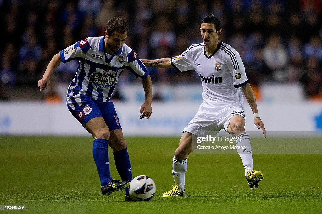 <a gi-track='captionPersonalityLinkClicked' href=/galleries/search?phrase=Angel+Di+Maria&family=editorial&specificpeople=4110691 ng-click='$event.stopPropagation()'>Angel Di Maria</a> (L) of Real Madrid CF competes for the ball with Ayoce D'az of RC Deportivo La Coruna during the La Liga match between RC Deportivo La Coruna and Real Madrid CF at Riazor Stadium on February 23, 2013 in La Coruna, Spain.