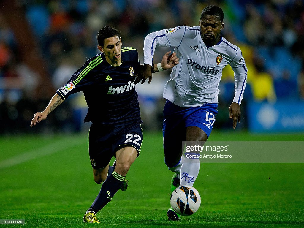 <a gi-track='captionPersonalityLinkClicked' href=/galleries/search?phrase=Angel+Di+Maria&family=editorial&specificpeople=4110691 ng-click='$event.stopPropagation()'>Angel Di Maria</a> (L) of Real Madrid CF competes for the ball with Christian Romaric (R) of Real Zaragoza during the La Liga match between Real Zaragoza and Real Madrid CF at La Romareda Stadium on March 30, 2013 in Zaragoza, Spain.