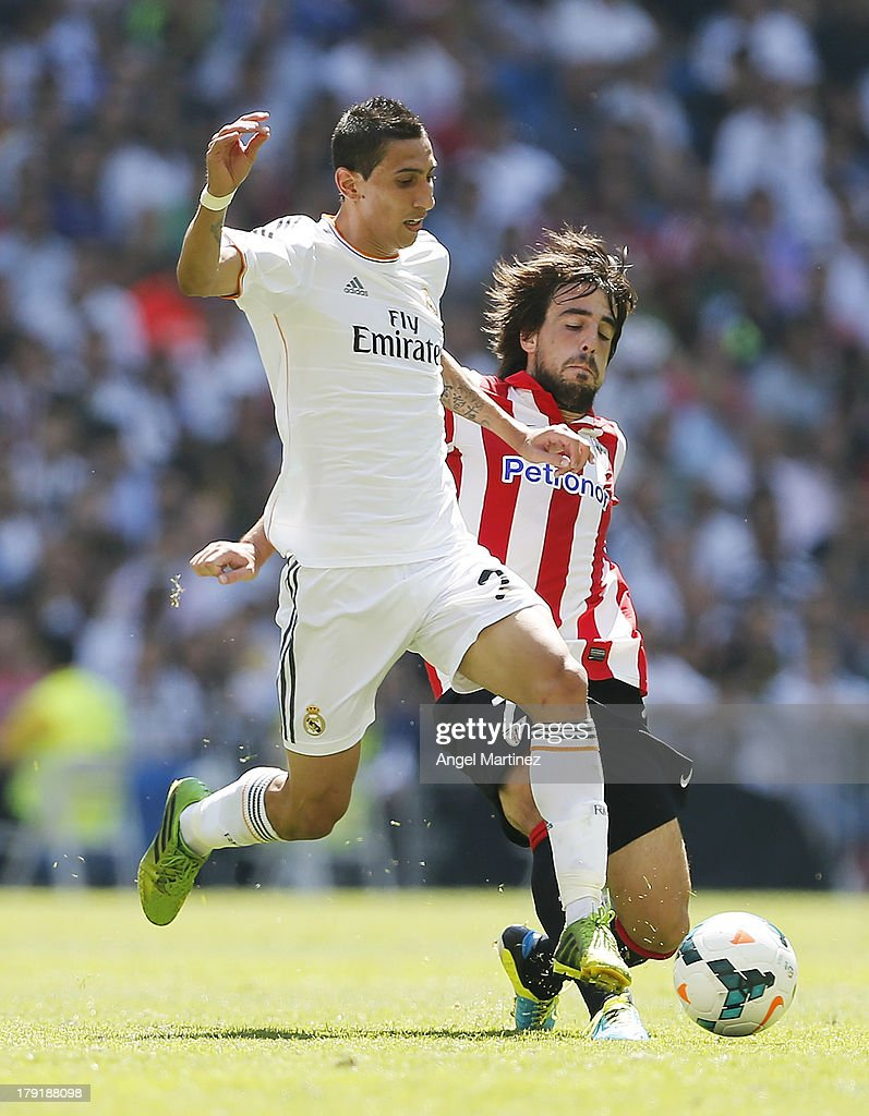 Angel di Maria of Real Madrid duels for the ball with Benat Etxebarria of Athletic Club during the La Liga match between Real Madrid and Athletic Club at Estadio Santiago Bernabeu on September 1, 2013 in Madrid, Spain.