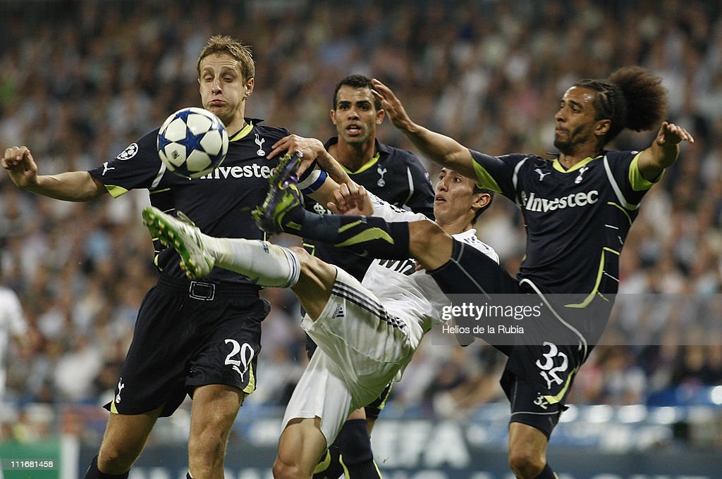 Angel di Maria (C) of Real Madrid duels for the ball with <a gi-track='captionPersonalityLinkClicked' href=/galleries/search?phrase=Michael+Dawson+-+Soccer+Player&family=editorial&specificpeople=453217 ng-click='$event.stopPropagation()'>Michael Dawson</a> (L) and <a gi-track='captionPersonalityLinkClicked' href=/galleries/search?phrase=Benoit+Assou-Ekotto&family=editorial&specificpeople=709848 ng-click='$event.stopPropagation()'>Benoit Assou-Ekotto</a> of Tottenham during the UEFA Champions League quarter final first leg match between Real Madrid and Tottenham at Estadio Santiago Bernabeu on April 5, 2011 in Madrid, Spain.