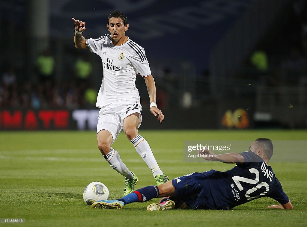 Angel di Maria of Real Madrid is challenged by <a gi-track='captionPersonalityLinkClicked' href=/galleries/search?phrase=Gael+Danic&family=editorial&specificpeople=650403 ng-click='$event.stopPropagation()'>Gael Danic</a> of Olympique Lyonnais during the pre-season friendly match between Olympique Lyonnais and Real Madrid at Gerland Stadium on July 24, 2013 in Lyon, France.