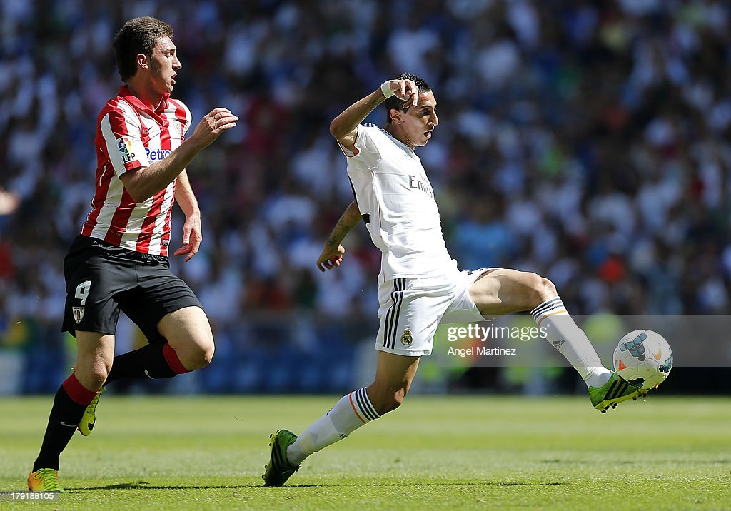 Angel di Maria of Real Madrid is chased by Aymeric Laporte of Athletic Club during the La Liga match between Real Madrid and Athletic Club at Estadio Santiago Bernabeu on September 1, 2013 in Madrid, Spain.