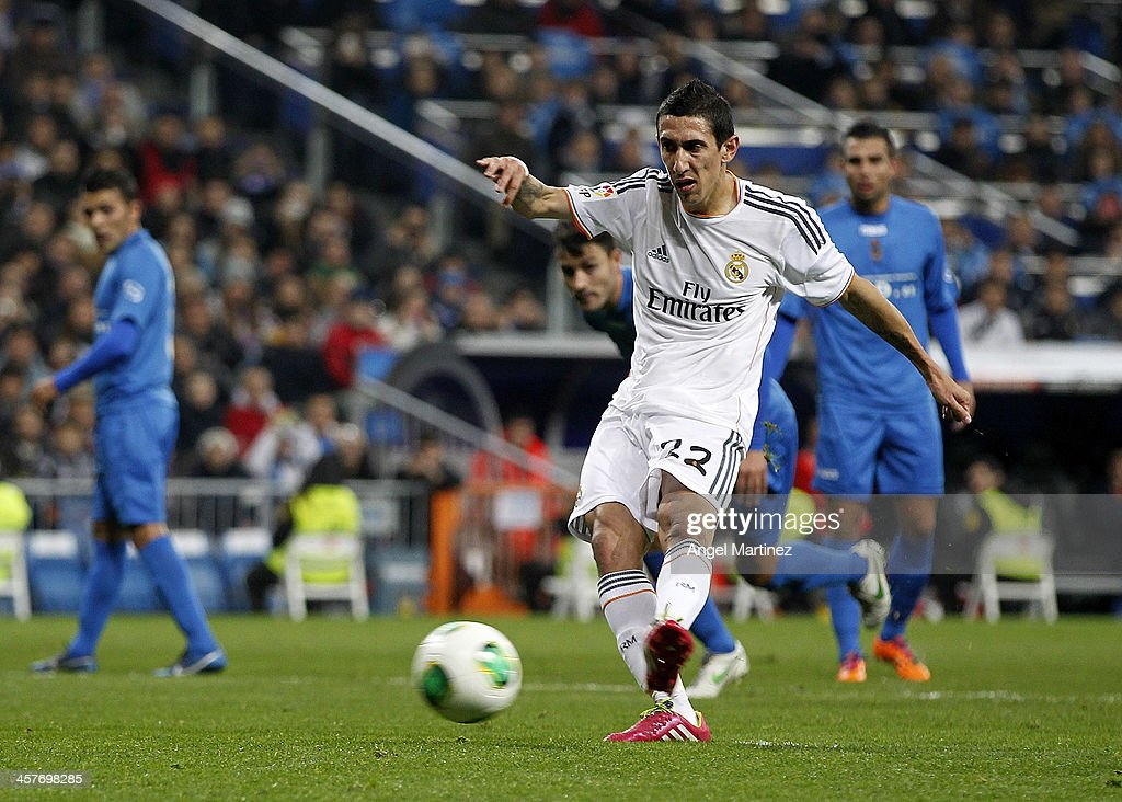 Angel di Maria of Real Madrid scores from penalty spot his team's second goal during the Copa del Rey, round of 32 match between Real Madrid and Olimpic de Xativa at Estadio Santiago Bernabeu on December 18, 2013 in Madrid, Spain.