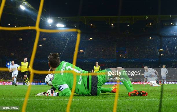 Angel Di Maria of Real Madrid takes his penalty which was saved by Roman Weidenfeller of Borussia Dortmund during the UEFA Champions League Quarter...
