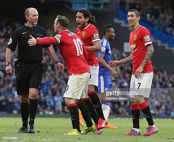 Angel di Maria Radamel Falcao and Wayne Rooney of Manchester United appeal to referee Mike Dean to give a penalty for a foul on Ander Herrera during...