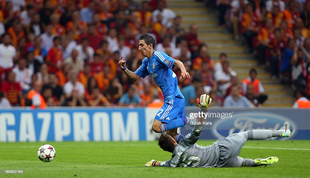 <a gi-track='captionPersonalityLinkClicked' href=/galleries/search?phrase=Angel+Di+Maria&family=editorial&specificpeople=4110691 ng-click='$event.stopPropagation()'>Angel Di Maria</a> rides the ball past Galatasaray's goalkeeper <a gi-track='captionPersonalityLinkClicked' href=/galleries/search?phrase=Fernando+Muslera&family=editorial&specificpeople=4283031 ng-click='$event.stopPropagation()'>Fernando Muslera</a> during UEFA Champions League Group B match at the Ali Sami Yen Area on September 17, 2013 in Istanbul, Turkey.
