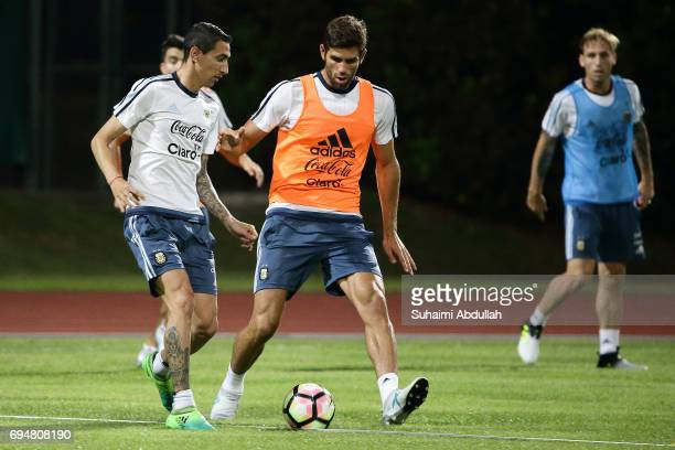 Angel Di Maria tries to dribble past Federico Fazio of Argentina during a training session at Bishan Stadium on June 11 2017 in Singapore Argentina...