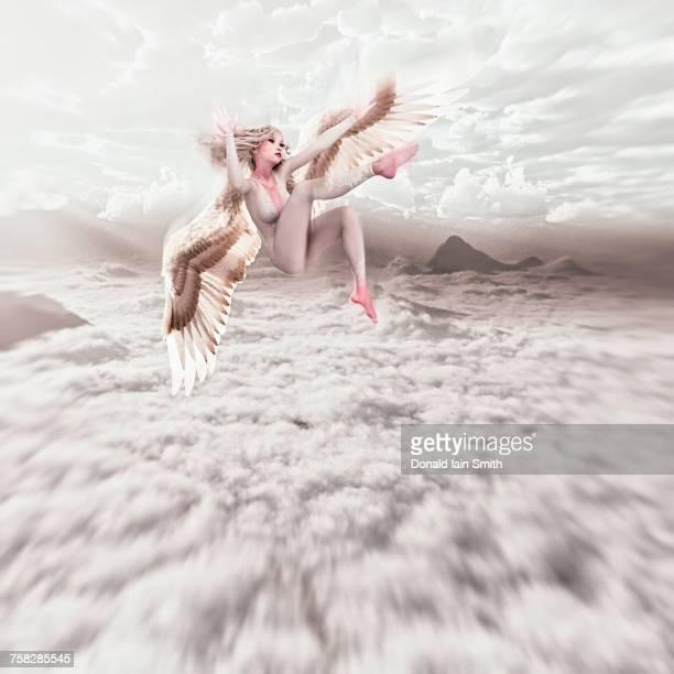 Angel falling in cloudy sky