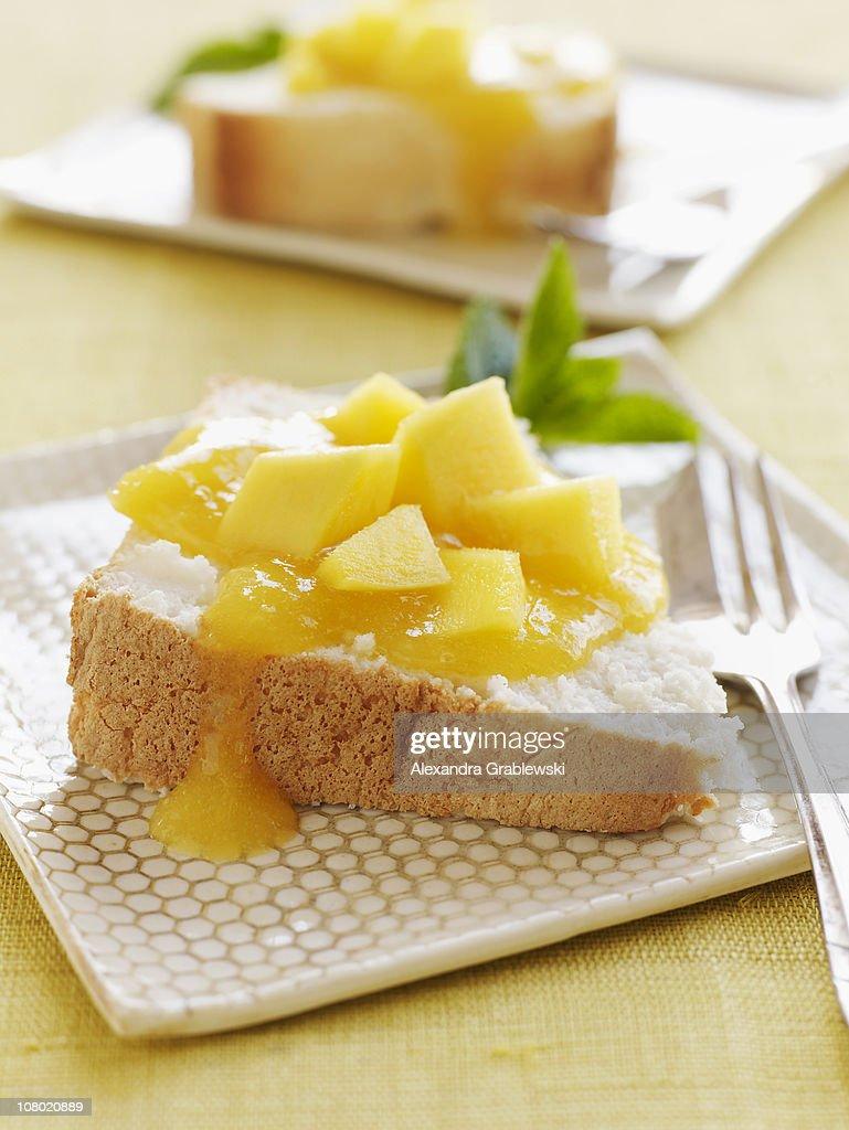Angel Food Cake with Mango Sauce : Stock Photo