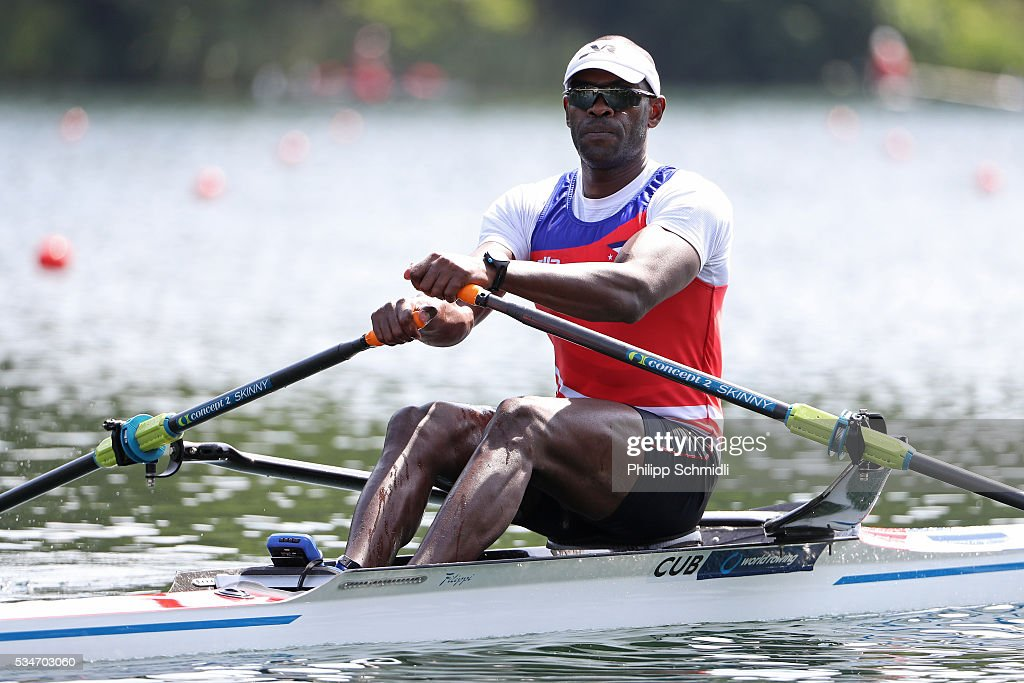 <a gi-track='captionPersonalityLinkClicked' href=/galleries/search?phrase=Angel+Fournier&family=editorial&specificpeople=4416416 ng-click='$event.stopPropagation()'>Angel Fournier</a> Rodriguez of Cuba competes in the Men's Single Sculls quarterfinals during day 1 of the 2016 World Rowing Cup II at Rotsee on May 27, 2016 in Lucerne, Switzerland.