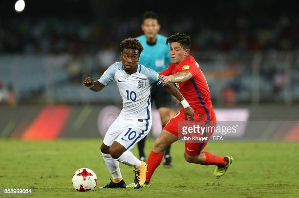 Angel Gomes of England holds off Sebastian Valencia of Chile during the FIFA U17 World Cup India 2017 group F match between Chile and England at...