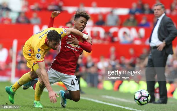 Angel Gomes of Manchester United in action with Joel Ward of Crystal Palace during the Premier League match between Manchester United and Crystal...