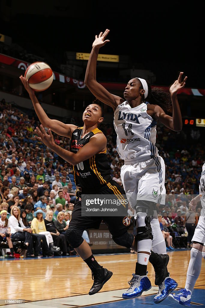 Angel Goodrich #10 of the the Tulsa Shock attempts to shoot against Devereaux Peters #14 of the Tulsa Shock during the WNBA game on August 16, 2013 at Target Center in Minneapolis, Minnesota.