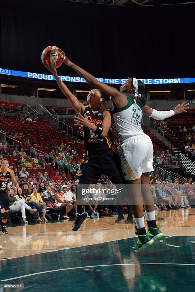 Angel Goodrich #10 of the Tulsa Shock drives to the basket against Camille Little #20 of the Seattle Storm during the game on August 10,2014 at Key Arena in Seattle, Washington.