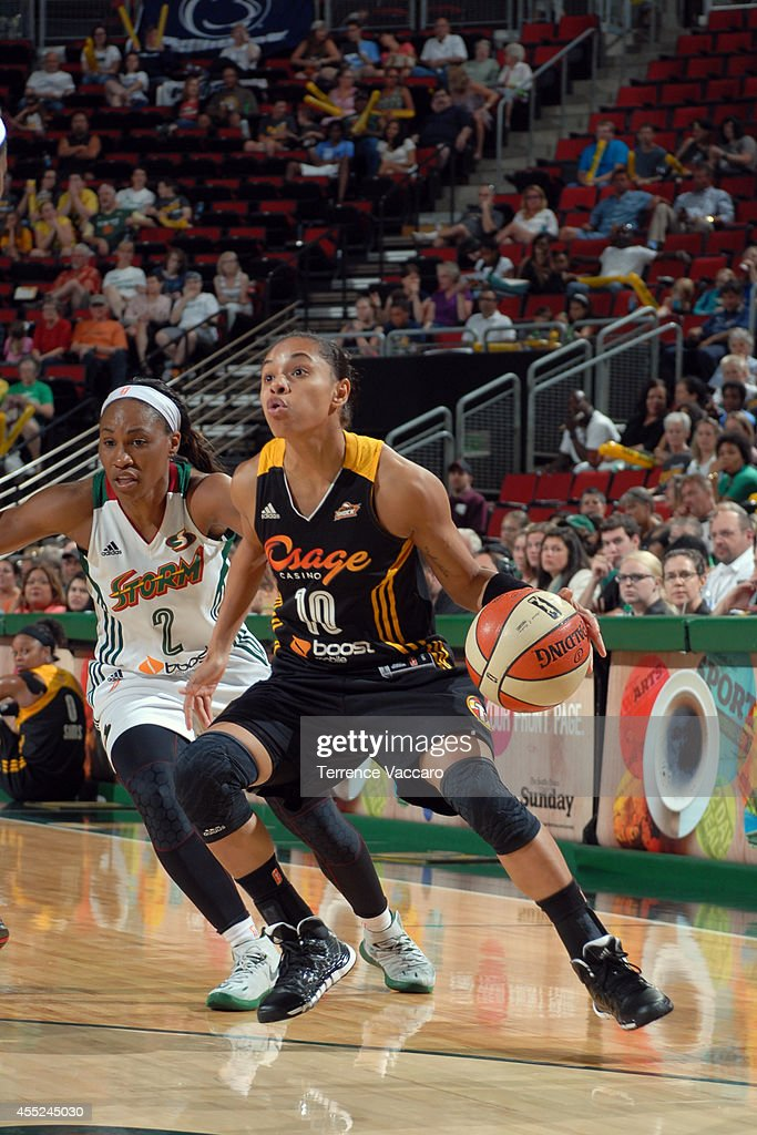 Angel Goodrich #10 of the Tulsa Shock handles the ball against Temeka Johnson #2 of the Seattle Storm during the game on August 10,2014 at Key Arena in Seattle, Washington.