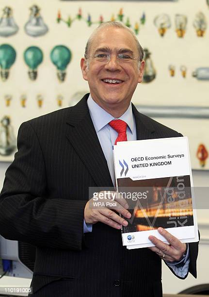 Angel Gurria OECD SecretaryGeneral poses at the Treasury during the launch of the Organisation for Economic Cooperation and Development's Economic...