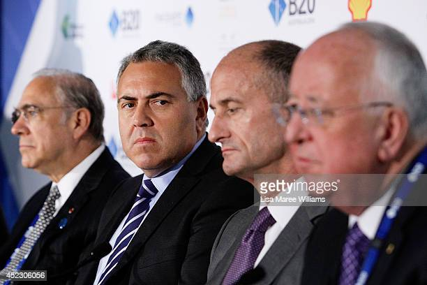 Angel Gurria SecretaryGeneral OECD Joe Hockey Australian Treasurer John Rice CEO GE Global Growth and Operations and Sam Walsh CEO Rio Tinto attend a...