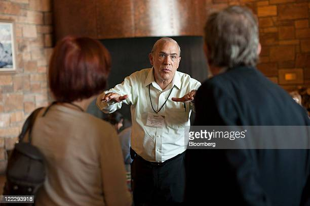 Angel Gurria secretarygeneral of the Organization for Economic Cooperation and Development talks with colleagues about going white water rafting...