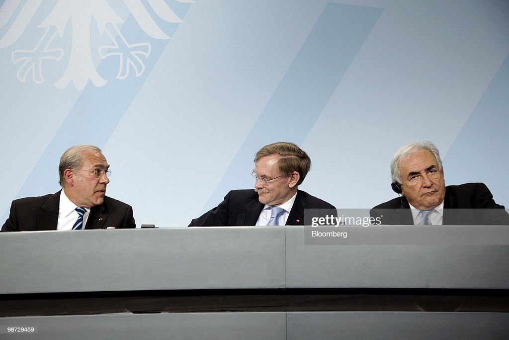 Angel Gurria, secretary-general of the Organization for Economic Cooperation and Development (OECD), from left, Robert Zoellick, president of the World Bank, and Dominique Strauss-Kahn, managing director of the International Monetary Fund (IMF), hold a news conference at the German federal chancellory in Berlin, Germany, on Wednesday, April 28, 2010. German Chancellor Angela Merkel and the IMF pledged to step up efforts to overcome the Greek fiscal crisis as Standard & Poor's downgraded Spain and investors sold bonds in Europe's most indebted nations. Photographer: Michele Tantussi/Bloomberg via Getty Images