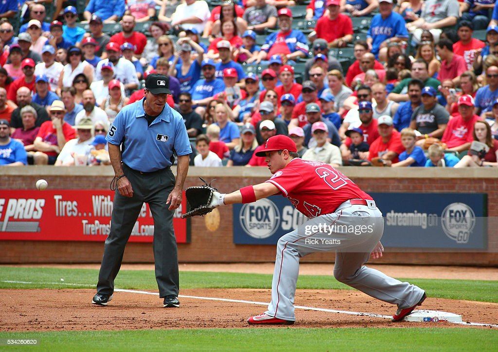 <a gi-track='captionPersonalityLinkClicked' href=/galleries/search?phrase=Angel+Hernandez&family=editorial&specificpeople=242828 ng-click='$event.stopPropagation()'>Angel Hernandez</a> #55 umpire looks on as Adrian Beltre #29 of the Texas Rangers is thrown out on first base in the first inning against C.J. Cron #24 of the Los Angeles Angels of Anaheim at Global Life Park in Arlington on May 25, 2016 in Arlington, Texas.