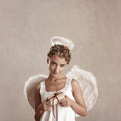 angel holding a wrapped gift
