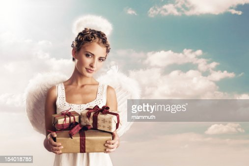angel holding christmas gifts