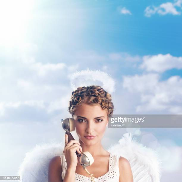 angel holding telephone receiver