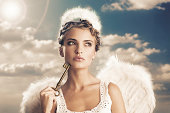 angel holding the key of heaven