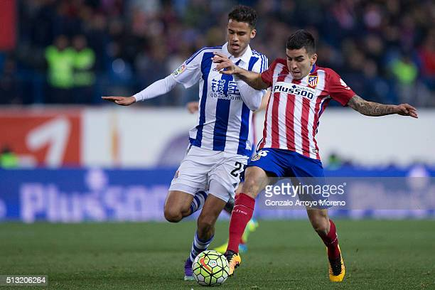 Angel Martin Correa of Atletico de Madrid competes for the ball with Diego Reyes of Real Sociedad de Futbol during the La Liga match between Club...