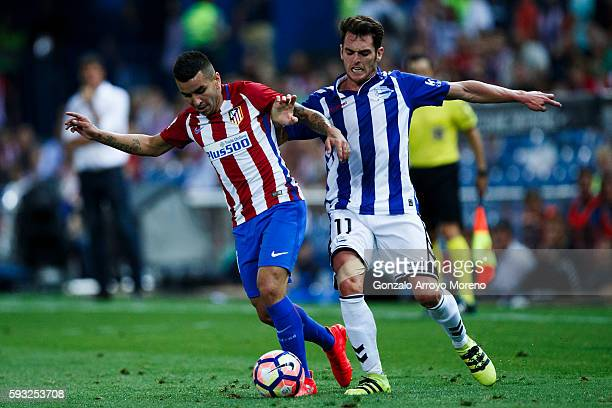 Angel Martin Correa of Atletico de Madrid competes for the ball with Ibai Gomez of Deportivo Alaves during the La Liga match between Club Atletico de...
