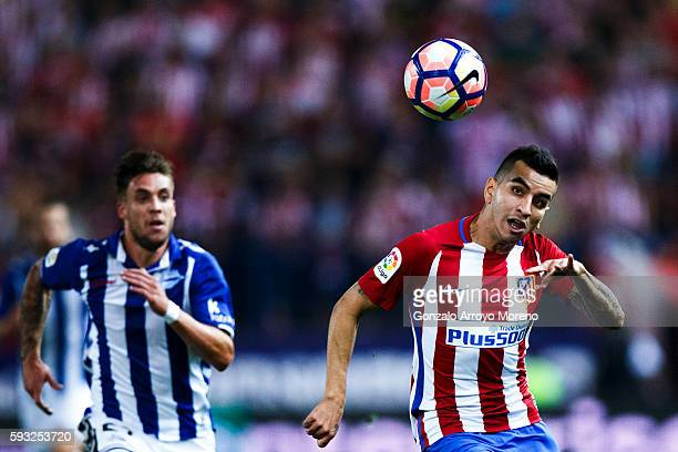 Angel Martin Correa of Atletico de Madrid competes for the ball with Kiko Femenia of Deportivo Alaves during the La Liga match between Club Atletico...