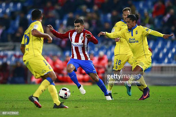 Angel Martin Correa of Atletico de Madrid competes for the ball with Mauricio Lemos of UD Las Palmas and his teammates Javier Castellano and Aythami...
