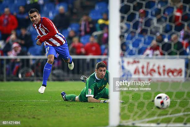 Angel Martin Correa of Atletico de Madrid scores their second goal across goalkeeper Raul Lizoain of UD Las Palmas during the Copa del Rey Round of...