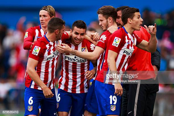Angel Martin Correa5 celebrates scoring their opening goal with teammates during the La Liga match between Club Atletico de Madrid and Malaga CF at...